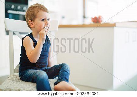 Beautiful child earing icecream in living room