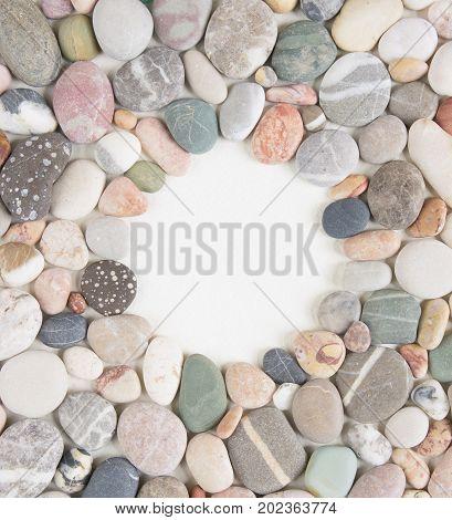 Sea pebble sea stones background. Sea pebbles frame