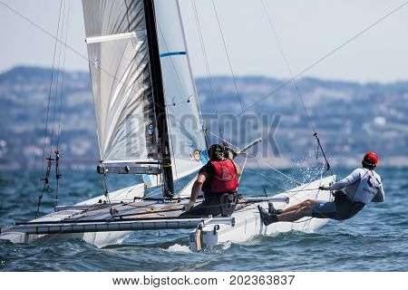 Athletes Yachts In Action During