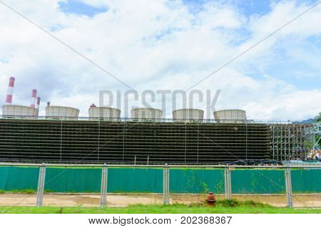 Cooling Tower Of Coal Fired Power Plant With Blue Sky And Clouds.
