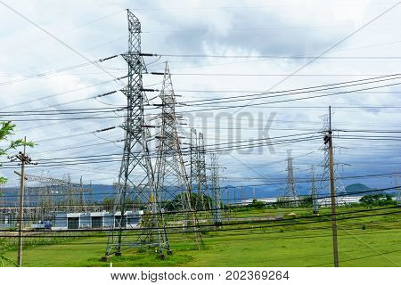 High Voltage Electricity Pylon With Transmission Line Near Electricity Station In The Filed With Clo