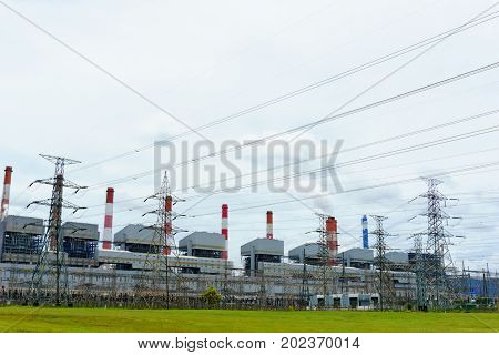 High Voltage Electricity Station And 500 Kv Pylon And Group Of Coal Fired Power Plant And Stack With