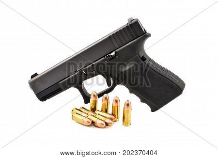 Automatic 9 m.m handgun pistol with bullet 9 m.m lead round nose isolated on a white background