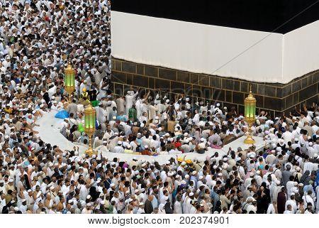 Mecca Saudi Arabia - September 9 2016: Muslim pilgrims put on their white ihrams praying in hijr ismail next to the holy Kaaba during Hajj in Saudi Arabia