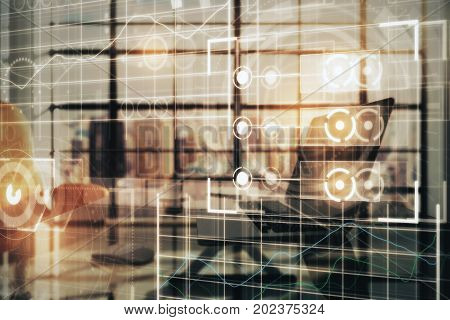 Side view of workplace with laptop coffee cup other items and abstract digital grid interface. Future and innovation concept. Double exposure