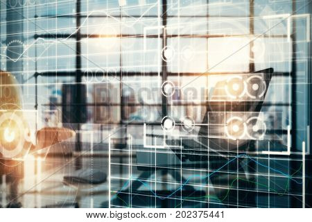 Side view of workplace with laptop coffee cup other items and abstract digital grid interface. Future and analytics concept. Double exposure