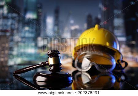 Law theme. Construction law's symbols  - helmet and gavel.