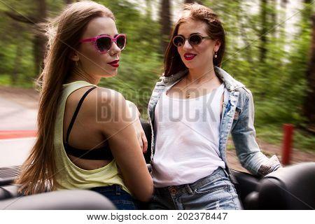 two young pretty girls have fun in cabrio