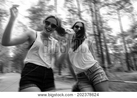 two cool girls having fun in cabrio black and white