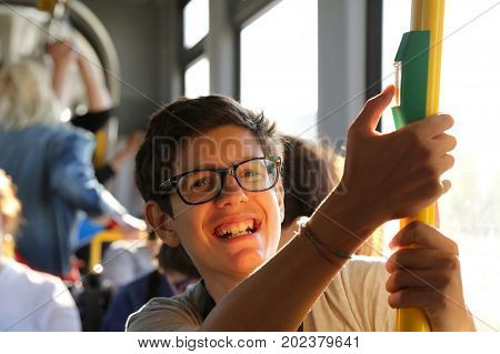 Smiling Boy With Stylish Glasses Travels By Tram