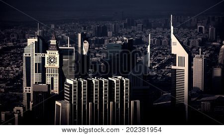 Dubai city evening cityscape, urban scene of luxury town, beautiful tall skyscraper, financial center of the Asia, United Arab Emirates