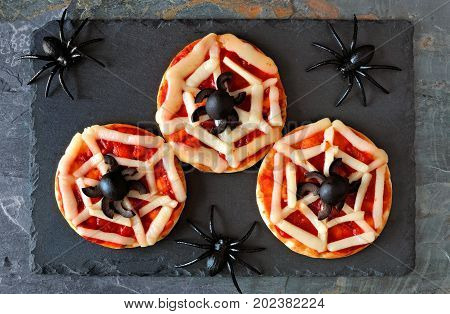 Halloween Spider Web Mini Pizzas, Overhead View On A Slate Server With Spiders