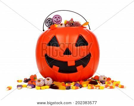 Black Halloween Jack O Lantern Candy Collector With Scattered Candy Over A White Background