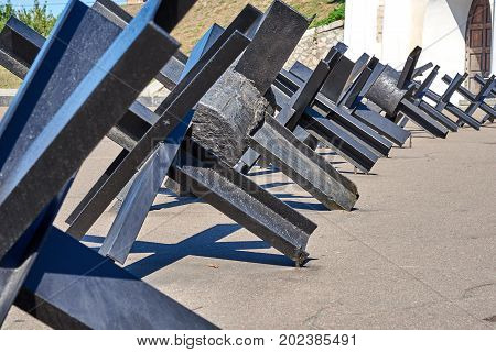 Black antitank fence of welded metal construction