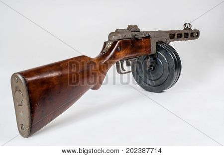 submachine gun ppsh-41 on a light background. The view from behind.