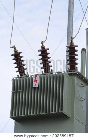 Olive Color Electric Transformer Closeup with Clear Sky