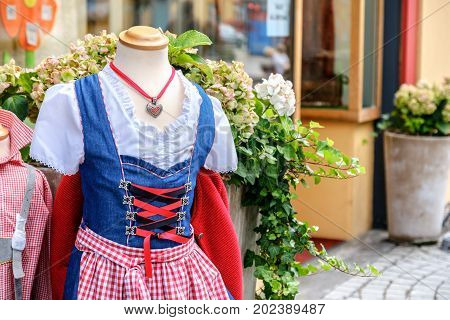 tyrol traditional clothes blue corset necklace red