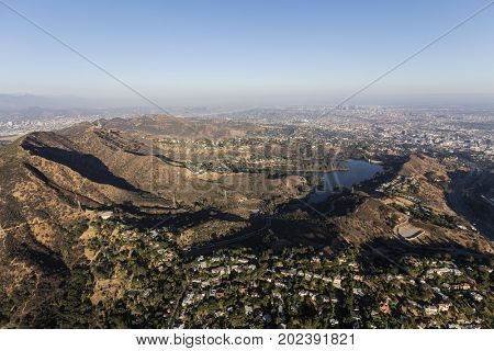 Aerial view of Mt. Lee, Mt. Hollywood, Griffith Park and hillside homes in Los Angeles, California.