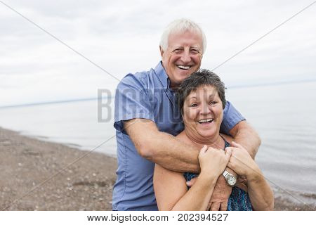 A Portrait of loving senior couple at the beach