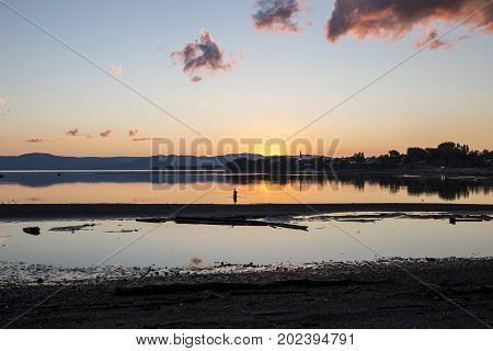 A Sunset on Gaspesie Canada with fisherman backlit