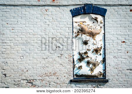 A white wall on an abandoned wall in northern Wisconsin.
