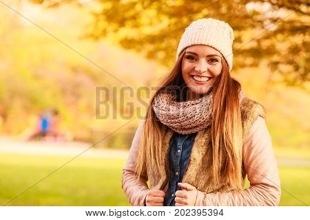 Smiling Woman Relaxing Outdoor In Autumnal Park