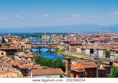 Florence city panorama background with view on Arno river and Ponte Vecchio bridge. Italy.
