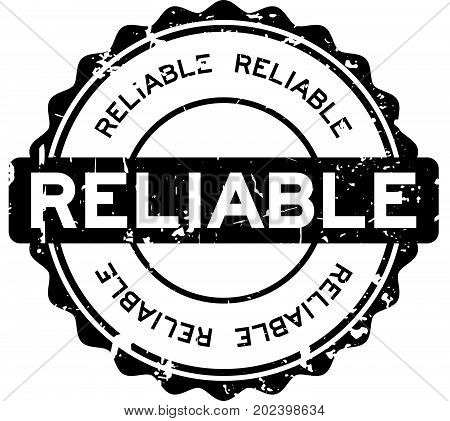 Grunge black reliable round rubber seal stamp on white background