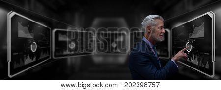 Portrait of senior businessman in big rack futuristic server room
