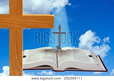 The Bible is the good book with cross.