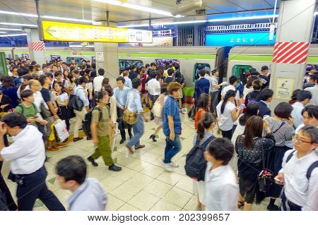 TOKYO, JAPAN - CIRCA MAY 2014: Passengers hurry at Ikebukuro station in Tokyo, Japan. Ikebukuru is the second-busiest railway station in the world.