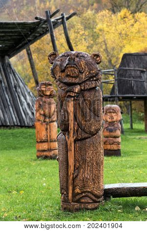 ESSO VILLAGE KAMCHATKA PENINSULA RUSSIA - SEP 18 2013: Traditional wood carving - wooden sculpture of Kamchatka brown bear. Bystrinsky Ethnographic Museum in Bystrinsky Region on Kamchatka Region.
