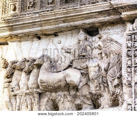 Titus Chariot Arch Roman Forum Rome Italy. Stone arch was erected in 81 AD in honor of Emperor Vespasian and his son Titus for conqueiring Jerusalem and destroying the Jewish temple in 70 AD. The Colosseum and the Arch were funded by the riches collected