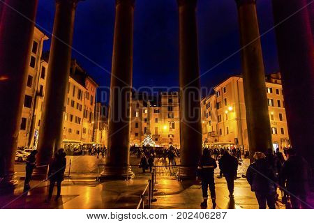 ROME, ITALY - January 19, 2017 Pantheon Columns Della Porta Fountain Piazza della Rotunda Pantheon Rome Italy. Fountain created in 1575 by Giacomo Della Porte. Pantheon oldest Roman church and oldest intact Roman building built 118 AD on spot of old Panth