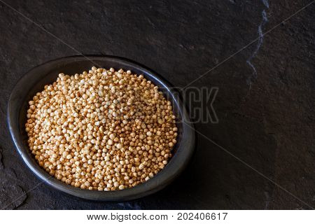 Puffed Quinoa Seeds (chenopodium Quinoa) In A Traditional Black Clay Dish