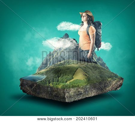 Young woman with the backpack on cube of mountain scenery