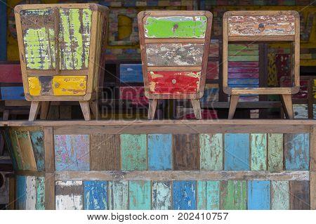 Old vintage shabby furniture wood texture in Ubud market island Bali Indonesia . Close up