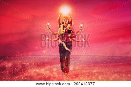 Shiva with eight hands fantasy concept. Woman dancing with snake on pink background.