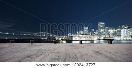 empty concrete floor and cityscape of san francisco at night