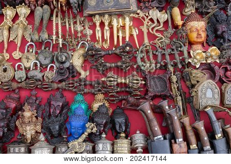 Vadjras statuettes knives and handicrafts on sale in the Thamel District Durbar Square Kathmandu Nepal
