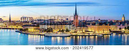 Panoramic view on Stockholm skyline in Old Town (Gamla Stan) in the evening Sweden