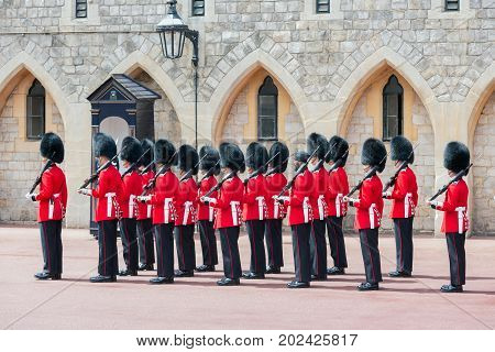 WINDSOR ENGLAND - JUNE 09 2017: Changing guard ceremony in Windsor Castle country house queen of England