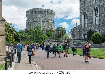 WINDSOR ENGLAND - JUNE 09 2017: People visiting Windsor Castle country house queen of England