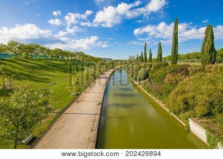 landscape of waterway in public park named Juan Carlos in Madrid city Spain