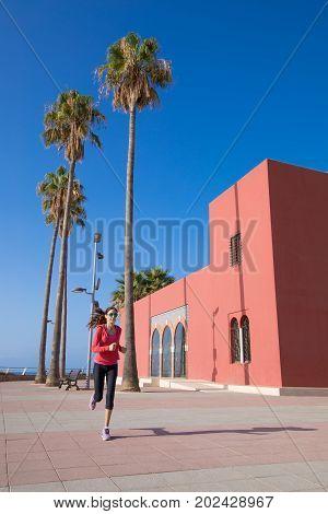 Woman Running In Promenade Of Benalmadena