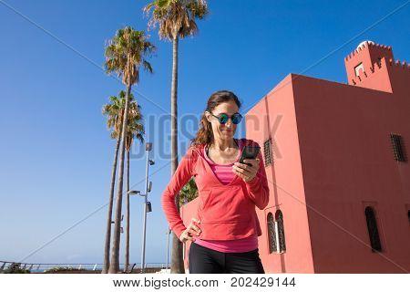 Woman Using Cellphone In Promenade Of Benalmadena
