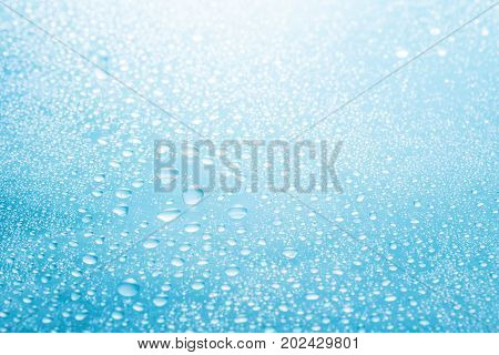 Abstract background drops of water close-up on a blue background