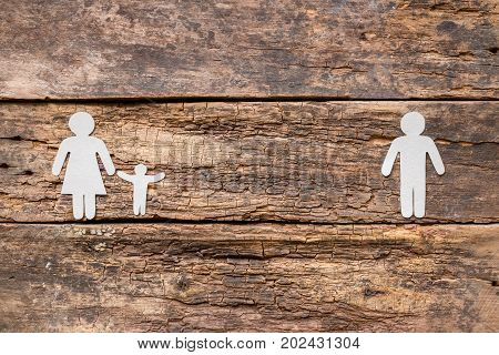 Paper Family On A Wooden Background - Child With Mother After A Divorce