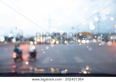 blurred of car on road. bokeh lights from traffic jam on night time for background.