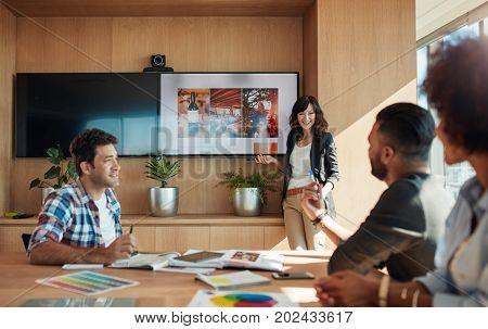 Female Coworker Making Presentation In Office